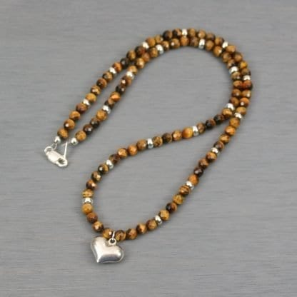 Sterling silver puffed heart pendant on strand of tiger eye and sterling silver