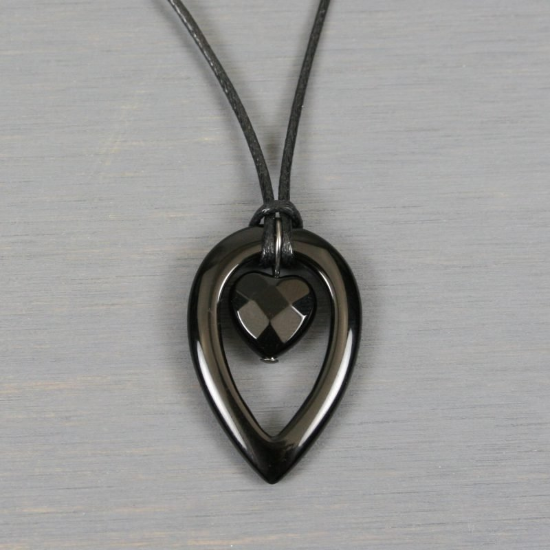 Black onyx framed heart pendant on black cotton cord necklace
