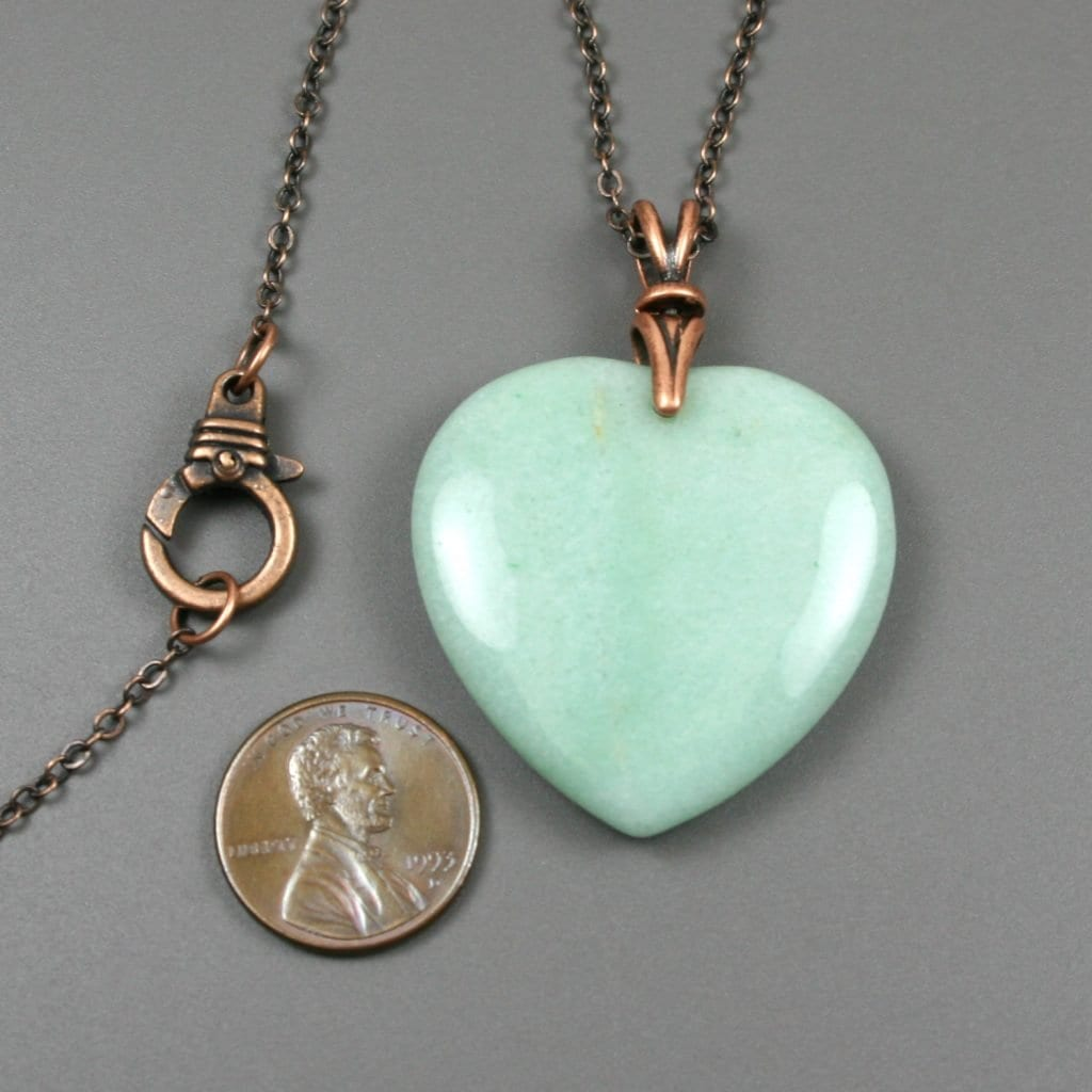 Green aventurine heart pendant on antiqued copper chain