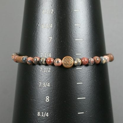 Leopardskin jasper stacking stretch bracelet with an antiqued copper Celtic knot focal and copper tube accents