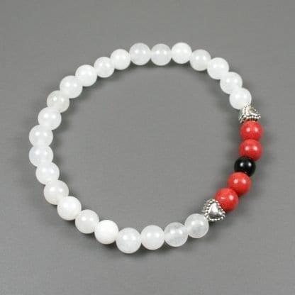 Coral dolomite, obsidian and snow quartz stacking stretch bracelet with antiqued silver plated heart accents