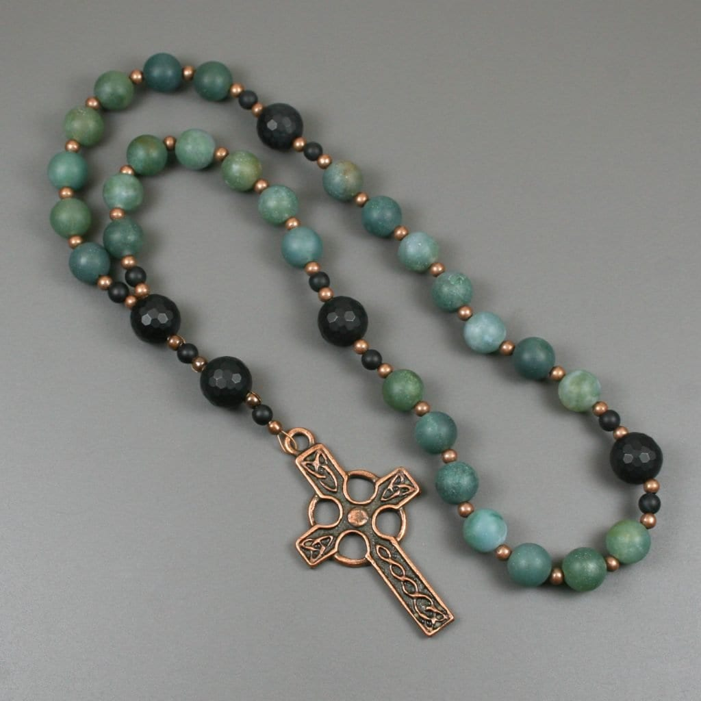 Anglican rosary in matte moss agate and black onyx with an antiqued copper Celtic cross