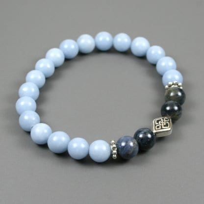 Dumortierite and blue angelite stacking stretch bracelet with a Celtic knot focal bead