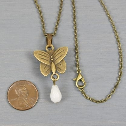 Turquoise howlite butterfly pendant with snow quartz teardrop on antiqued brass cable chain