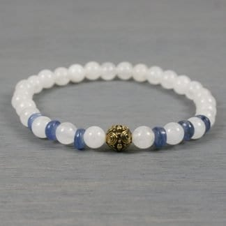 Blue kyanite and snow quartz stretch bracelet with an antiqued gold plated fancy spiral accent bead