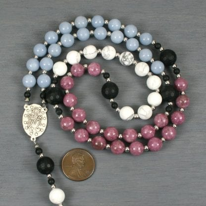 Roman Catholic rosary in blue angelite, lepidolite, and white howlite in a trans flag pattern