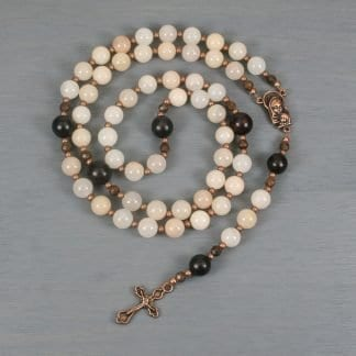 Pink aventurine, buri root, wood, and antiqued copper rosary in the Roman Catholic style