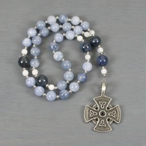 Anglican rosary in blue-purple jade, dumortierite, and snow quartz with a pewter cross with Celtic trinity knots